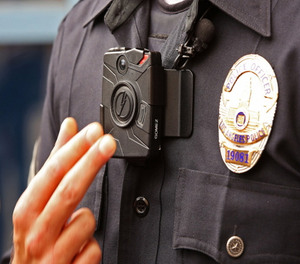 Officer Jim Stover demonstrates an LAPD body camera.
