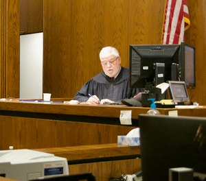 Cuyahoga County Common Pleas Court Judge Robert McClelland presides over arraignment hearings on Saturday in an effort to move people out of the Cuyahoga County Jail over concerns about the coronavirus.