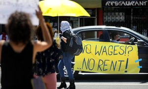 Members of the Los Angeles Tenants Union and their supporters hold a demonstration on Wednesday, April 1, 2020 to demand rent forgiveness for the month of April due to the coronavirus pandemic's economic fallout. Image: Christina House/Los Angeles Times via TNS