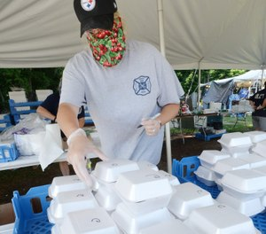 Danya Sotter, 38, boxes slices of cherry pie during a food sale replacing the canceled North East Cherry Festival on July 15. Volunteer fire and EMS department fundraisers have taken a major hit due to COVID-19 restrictions. (Photo/Greg Wohlford, Erie Times-News)