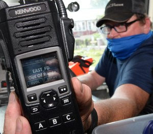 North East Fire Department Chief Dave Meehl shows his portable radio while riding a few miles away from the Crescent Hose Company in North East Borough. Meehl has been trying to resolve issues his department is having with the new Erie County radio system.