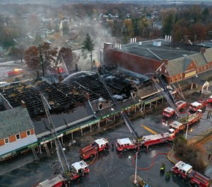 A three-alarm fire tore through the historic Edmondson Village Shopping Center in West Baltimore in November, damaging 10 businesses. More than 30 fires since July have left residents in Baltimore's southwestern region fearful their homes could be next to go up in flames. (Photo/Jerry Jackson, Baltimore Sun)