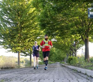 Former Woodstock firefighter Ryan Mains (right) runs with pace runner Leann McMonigan along the Fox River Trail, May 30, 2020 in Elgin, Illinois. After months of training, he was completed an 80-mile run to raise $18,000 to help first responders struggling with PTSD. (Photo/Stacey Wescott, Chicago Tribune)