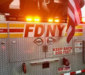 A man was charged with assaulting two firefighters who were assisting someone suffering a medical emergency in Queens on Tuesday.