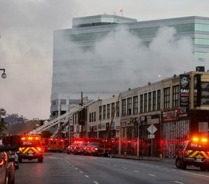 Firefighters battle a fire at the scene of a commercial fire at 327 E. Boyd St. downtown that injured 12 firefighters and left multiple buildings on fire. (Photo/Gary Coronado, Los Angeles Times)