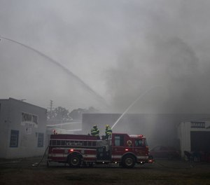 A firefighter suffered burns while battling a large commercial structure fire in Jackson County, Mich. on Wednesday. (Photo/J. Scott Park, MLive.com)