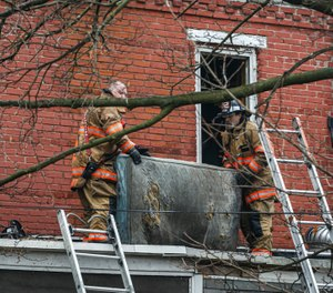 Firefighters responded to a fire at a duplex home in Harrisburg, Pa. on Thursday, Feb. 6. One firefighter became briefly trapped on the third floor while searching for residents but escaped injury. (Photo/Dan Gleiter, PennLive)