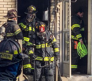 Fire service leaders must become more proactive in addressing the PPE needs of their fire departments. (Photo/Mike Nester via Tribune News Service)
