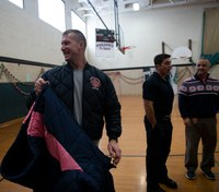 Mich. firefighters donate 180 coats to students