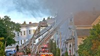 4 residents rescued from third floor of Mass. house fire