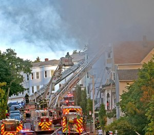 Smoke pours from 63 Harrison St. in Worcester on Thursday.