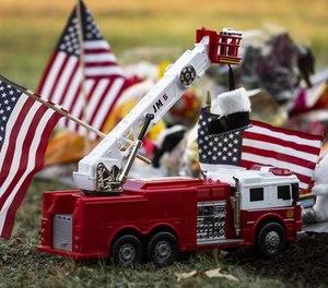 A growing memorial honoring Lt. Jason Menard is seen Friday outside the McKeon Road Fire Station in Worcester. [T&G Staff/Ashley Green]