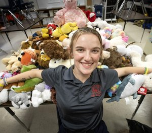 Hannah Jenkins, a senior at Bartow High School's Medical and Fire Academy, has collected nearly 200 stuffed animals at the school to comfort children enduring a traumatic situation. (Photo/Ernst Peters, The Ledger)
