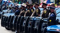 Funeral procession honors Mich. trooper killed in car crash