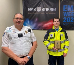 Andrew Molby, right, became an EMT for GEMS in Nov. 2019. Since then, he's graduated from Gaston College and been recognized as one of GEMS' Outstanding EMTs.