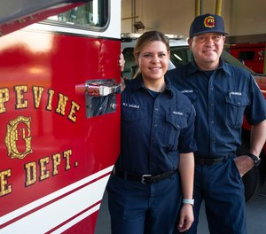 Firefighter driver-engineer and EMT Morris Leondar and his daughter, firefighter-paramedic Marissa Sauble, pose for a portrait at Fire Station 1 in Grapevine, Texas, on Saturday, Aug. 8, 2020. Leondar and Sauble are the first father-daughter duo to work together at the Grapevine Fire Department.