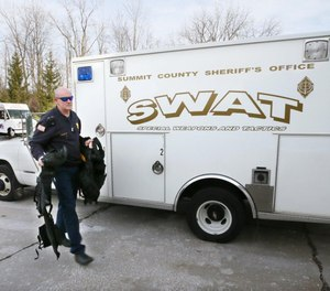 Green Fire Lt. Michael Mohr carries the gear he wears when working as a tactical paramedic for the SWAT team.