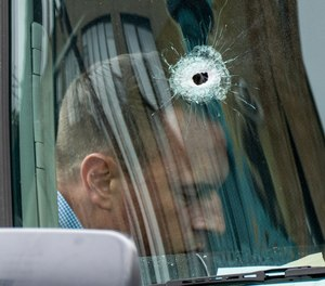 A bullet hole in the windshield of an Amazon vehicle after a shooting incident in Brooklyn, New York.
