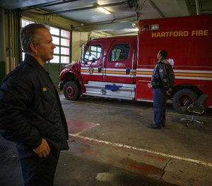 Hartford Fire Assistant Chief Dan Reilly, left, and retired Hartford Fire Chief Charles Teale stand in the former Hartford Fire Department headquarters on Pearl Street. (Photo/Mark Mirko, Hartford Courant)