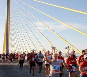 Justin Doyle, 48, collapsed and later died while running in the March 1 Skyway 10K race. A St. Petersburg Fire Rescue report reveals the confusion and miscommunications that delayed medical help. (Photo/Luis Santana, Tampa Bay Times)