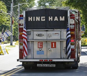 "A Hingham fire truck flying the ""thin blue line"