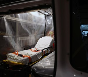 A ambulance that has been wrapped in plastic sheeting for transporting COVID-19 patients is pictured inside the Upper Merion Fire and EMS station in King of Prussia, Pa. The U.S. House of Representatives on Monday adopted legislation to ensure that families of first responders who are disabled or die from the virus get Public Safety Officers Benefit program payments.