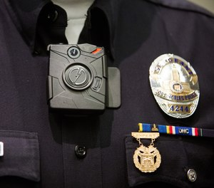 An LAPD officer wears a Taser Axon on-body camera during a press conference last December. (Photo/Los Angeles Times)