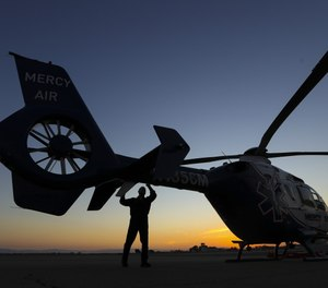 Pilot Michael Bobeck checks a Mercy Air air ambulance helicopter based at Imperial County Airport on Sunday, July 12, 2020 in Imperial, Calif. (Photo/Irfan Khan, Los Angeles Times)