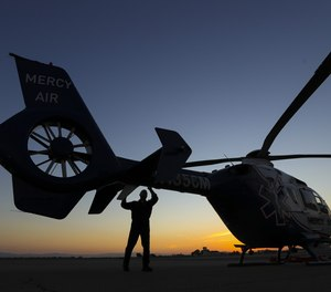Pilot Michael Bobeck checks a Mercy Air air ambulance helicopter based at Imperial County Airport on Sunday, July 12, 2020 in Imperial, Calif.
