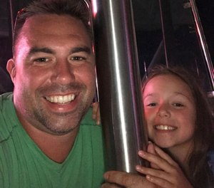 Fallen Worcester Firefighter Christopher Roy and his daughter, Ava. Momoh Kamara is charged with second-degree murder and arson in connection with the December 2018 blaze that killed Roy in the line of duty. (Photo/Contributed, masslive.com)