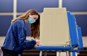 Ella Markley of Overland Park, Kansas, marks her paper ballot during advance voting at the Blue Valley School District's Hilltop Conference Center in Overland Park Thursday, July 30, 2020. Image: Jill Toyoshiba/The Kansas City Star via TNS