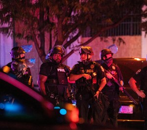 Louisville Metro Police block off Broadway after two officers were shot and a suspect was taken into custody after a march in protest of the decision concerning the officers involved in the killing of Breonna Taylor announced earlier on September 23, 2020, in Louisville, Kentucky.