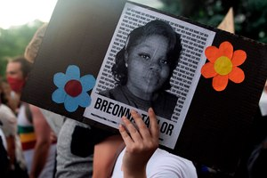 A demonstrator holds a sign with the image of Breonna Taylor, a black woman who was fatally shot by Louisville Metro Police Department officers, during a protest against police brutality, in Denver on June 3, 2020. Image: Jason Connolly/AFP/Getty Images via TNS