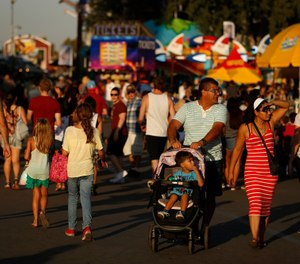 Crowds make their way through the expansive grounds at the Los Angeles County Fair in Pomona, Calif. on Sept. 23, 2015. ( Rick Loomis/Los Angeles Times/TNS)