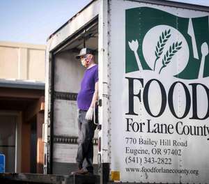 Lane Professional Firefighters, the local firefighters union, delivered a check for $17,500 to Food for Lane County on May 4, and an additional $2,500 will be donated to Florence Food Share.