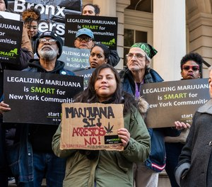State Senator Liz Krueger, right, with supporters of the Marijuana Regulation and Taxation Act (MRTA) rally on the steps of New York City Hall on November 21, 2019.