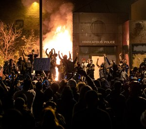 The Minneapolis Third Police Precinct is set on fire during a third night of protests following the death of George Floyd on Thursday, May 28, 2020.