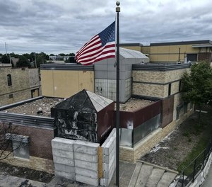 The Minneapolis 3rd Precinct, which held backup 911 equipment, was destroyed in last year's riots.