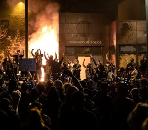 The Minneapolis Third Police Precinct is set on fire during a third night of protests following the death of George Floyd while in Minneapolis police custody, on May 28, 2020.