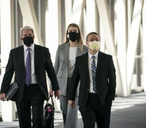 Former Minneapolis police officer Tou Thao, right, arrives with his lawyer Robert Paule, left, for a hearing at the Hennepin County Government Center in July. (Photo/Renee Jones Schneider/Minneapolis Star Tribune/TNS)