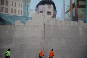 A crew from Mural Arts paints over a mural of divisive former mayor and police chief Frank Rizzo in Philadelphia.
