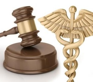 Dougherty and Green pleaded guilty to single felony counts of healthcare fraud and tax fraud earlier this year and were formally sentenced Monday.