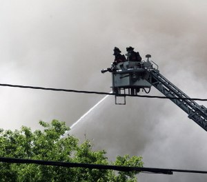 Firefighters work to extinguish flames created by a gas explosion in downtown Durham, N.C. The blast killed two and injured 25, including nine firefighters, on April 10, 2019. (Photo/Drew Jackson, Raleigh News & Observer, TNS)