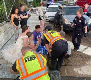 Nurse Rachel Taylor, 22, had just left her wedding when she witnessed a car crash and helped. (Photo/Courtesy of Calvin Taylor via New York Daily News)