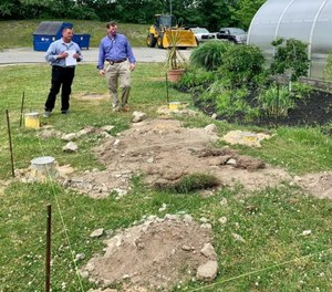 Assistant Deputy Superintendent Steve Randall, left, and Sheriff Jerry McDermott, right, at the proposed gardening site. (Photo/Norfolk County Sheriff's Office)