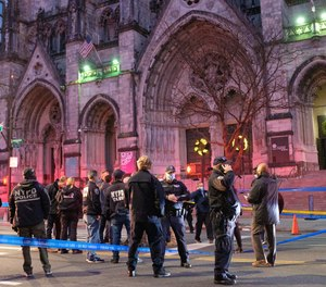 Police respond after a shooting incident outside the Cathedral of Saint John the Divine on West 112th Street and Amsterdam Avenue in Manhattan, New York City on Sunday, December 13, 2020.