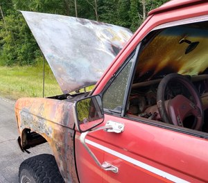 A pickup caught fire along U.S. Route 30 west of state Route 241 Monday afternoon. An off-duty firefighter, who happened to be driving a truck hauling water, doused the flames before firefighters arrived.