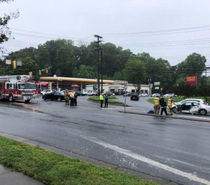 Gastonia Fire Department's Ladder 4 truck and a silver sedan collided on Cox Road near Franklin Boulevard Thursday morning. (Photo/Gavin Stewart, The Gaston Gazette)