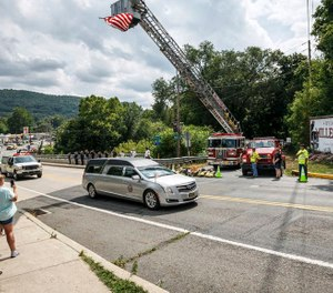 Halifax Firefighter Tyler A. Laudenslager was killed in July when he was struck while providing roadside assistance for his towing job. Pennsylvania senators have passed a bill imposing tougher penalties for motorists who fail to slow down or move over for first responders, tow truck drivers and others working on roadways. (Photo/Dan Gleiter, The Patriot-News)
