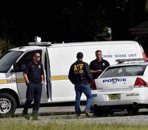 Police stand by at Ken Knight Drive following the shooting of a Jacksonville police officer outside a home on Rutledge Pearson Drive Monday morning. (Photo/Will Dickey, Florida Times-Union)